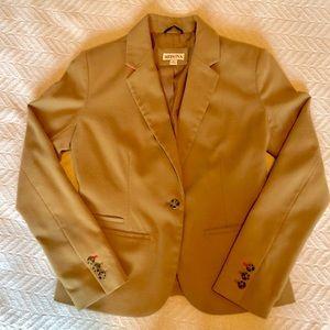 Brushed tan blazer with hot pink detail